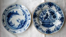 Two plates with bird and fisherman, 18th century