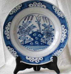 Delftware plate with flowers, 18th century