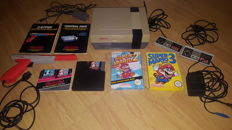 Nintendo NES Action set with 3 mario games + zapper