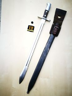 Long Swiss bayonet M 1914 Pioneer saw in very good condition with original frog and regiment number