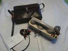 Old hand-cranked bakelite campaign phone in his leather bag - France - 1970s -