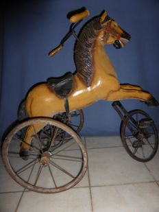Nice nostalgic painted wooden horse tricycle for a child - wood, cast iron and glass eyes