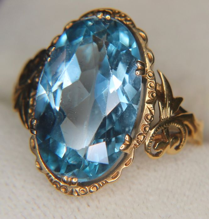 Antique handcrafted 14Kt. gold ring with a large 7.78ct Spinel on a beautifully decorated ring head in an excellent condition. **No Reserve**