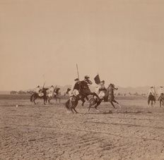 J.Kuhn (active from 1885 to 1905) Riders of fantasia in Biskra, Tunisia