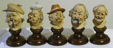 Five characteristic porcelain male heads