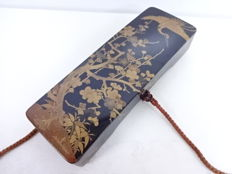 A lacquerware calligraphy box with maki-e crest and plum blossoms - Japan - Early 20th century