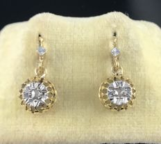 Pair of carved dangling sleeper earrings in 18 kt gold, decorated with diamonds, topped with a clover in grey gold **NO RESERVE**