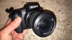 Sony DSLR-A-350 digital camera with 2 lenses, flash units in bag with various accessories