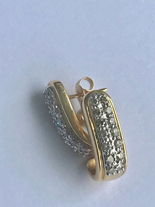 Bicolour earrings in 18 kt gold and diamonds, size approx. 17.52 x 6.35 mm