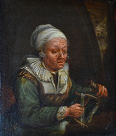 Follower of Gerrit Dou (18th/19th century) - Winding yarn.
