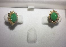 A pair of Jade and diamond ear studs in 18 kt gold
