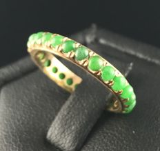 Antique 18 kt gold ring entirely set with apple green jadeite cabochons (total 1.3 ct)