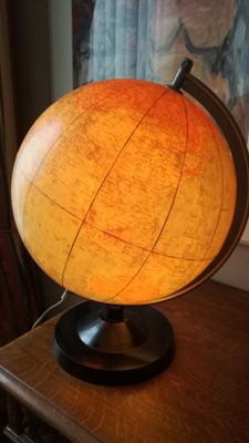 Illuminated globe from Leipzig with a Bakelite base