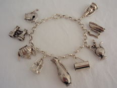 925/1000 silver Jasseron bracelet with 9 large 835/1000 vintage charms, L max 20.5 cm, can be worn in various ways, 28.1 g