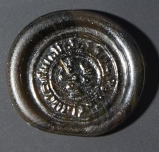 Islamic glass coin weight, Egypt, 10th–12th c A.D. 21mm