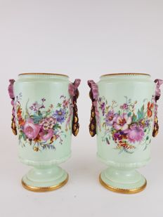 Pair of flower painted green porcelain vases