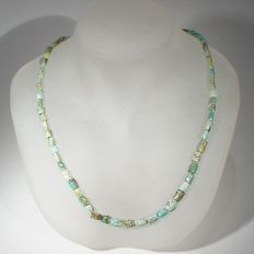 Necklace of beads of turquoise and turquoise matrix beads.