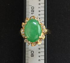 A Jadeite and Diamond ring - 18 kt gold;