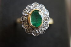 Two-tone ring with emerald centre and antique cut diamond entourage