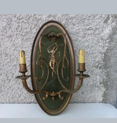 Sconce with the figure of a woman on velvet background - copper - France - ca. 1910