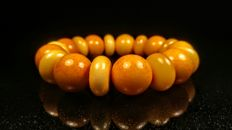 Vintage egg yolk colour round beads Baltic Amber bracelet, 43 grams from Yanatarny, Russia.