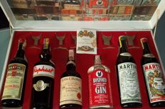 6 bottles liqueurs, Vermouth, Gin, Whiskey in o.w.c. Vintage Martini & Rossi 60s