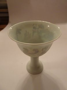 A  Chinese white celadon wine cup with dragon and phoenix decoration - 105 mm x 85 mm