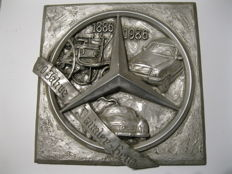Wall relief from tin 100 years of Daimler Benz 1886 - 1986 motif: Mercedes star with cars