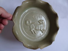 An green celadon dish with a moulded dog and flower decoration  - 190 X 50 mm