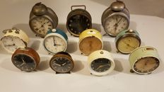 Collection of 11 old alarm clocks