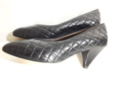 Chanel – women's court shoes with heel.