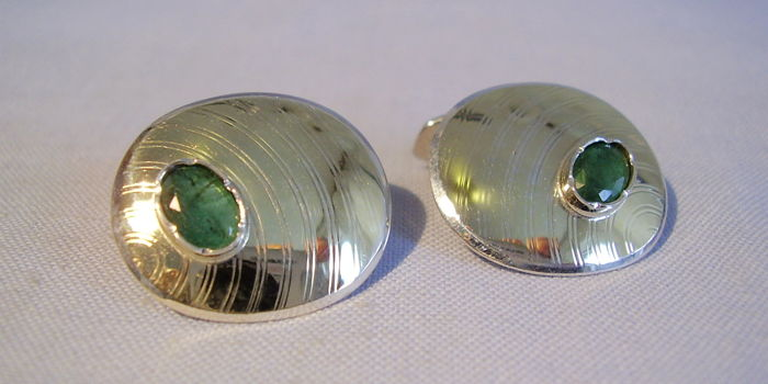 Antique, signed cufflinks with facetted, natural emeralds of 1.8 ct in total signed Hermann Mürrle Pforzheim circa 1930