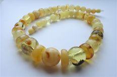 Natural Baltic Amber yellow and honey coloured necklace, weight 57 gram.