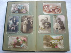 Nice collection of about 325 Romantic and Fantasy cards in old album, mainly couples, women, children and all kind of Seasonal greetings