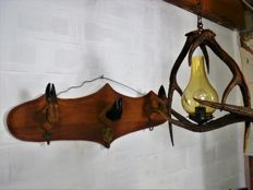Gun rack with 3 hat hooks and a light fitting made from antlers