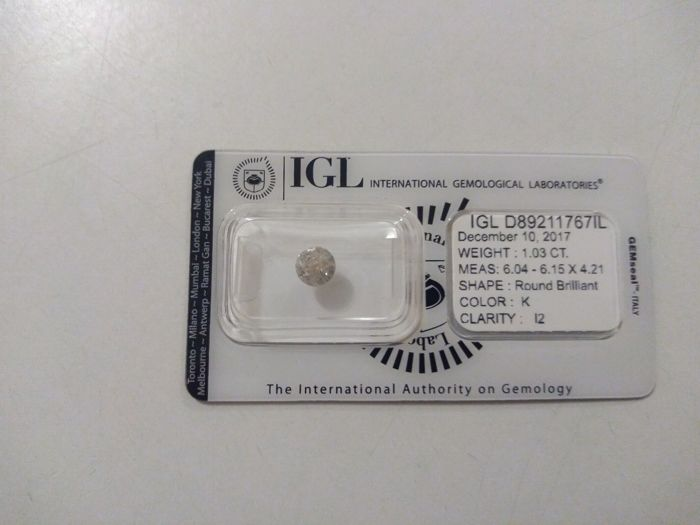 1.03ct round brilliant Color K. Clarity I2