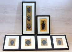 Collection of 6 African decorations in frame with glass