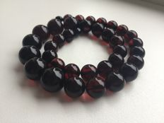 Pressed Baltic amber necklace (46 cm), dark cherry beads,