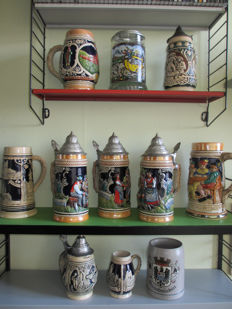 Collection of 11 beautiful beer mugs with various dimensions