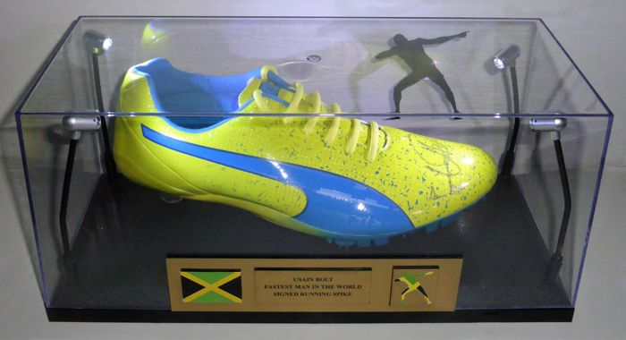 Usain Bolt - Rio Olympics - Puma Evo Speed Electric V2 Spike 2015 cleat shoe Hand signed by the Fastest Man Legend Usain Bolt with Original Led lighted display case + COA Ultra RARE!
