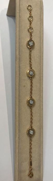 Bracelet with four circular elements paved with brilliant cut diamonds totalling approx. 0.28 ct