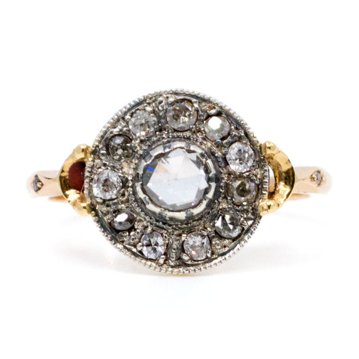 This ring features 0.55ct Rose Cut Diamond surrounded by 0.55ct Old Mine Cut Diamonds in 14k Gold and Silver.