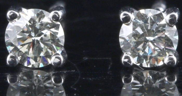 Solitaire ear studs set with two brilliant cut diamonds, 0.58 in total, 14 kt white gold