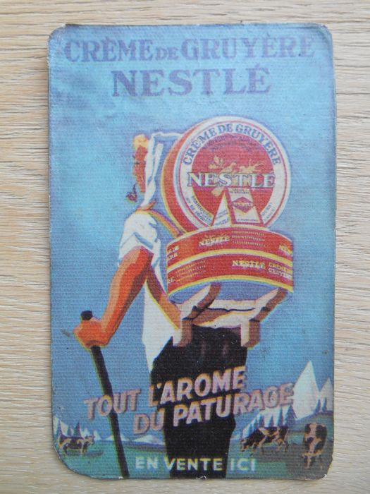 metal advertising sign for Nestlé