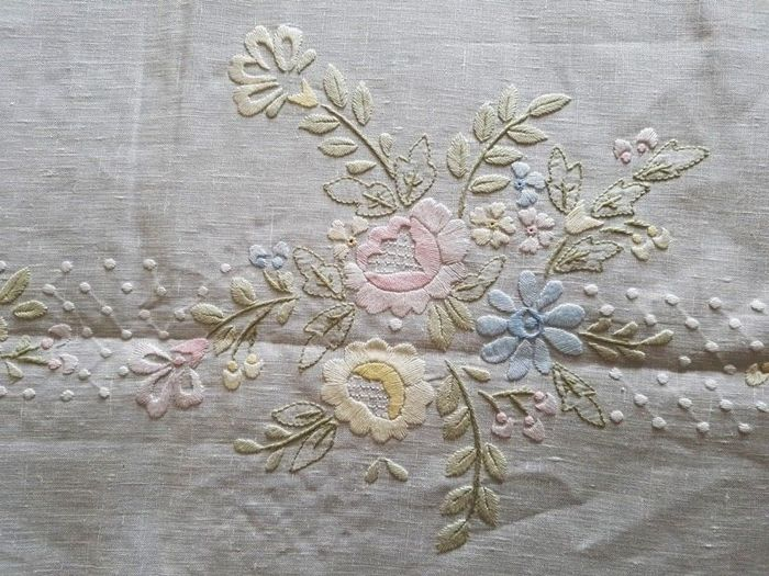 An extremely rare bedspread made of 100% pure linen with a floral embroidery in handmade satin stitch
