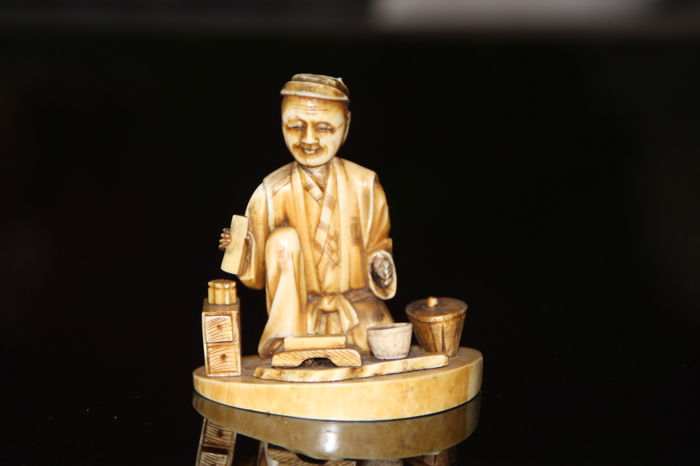 Antique signed Ivory carved okimono of old man working- Japan - 1900-1930
