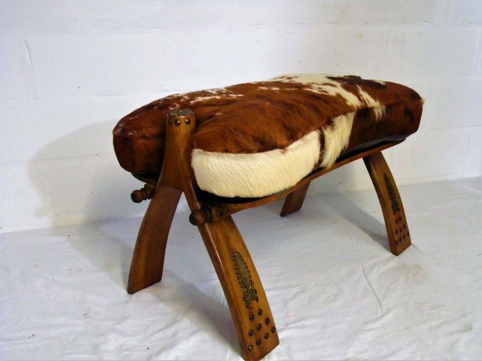 Camel saddle - bench / stool with cow leather cushion - ottoman - 2nd half of 20th century