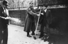 Unknown/Keystone - Jewish man forced to sweep the streets by a Nazi, Germany, 1939