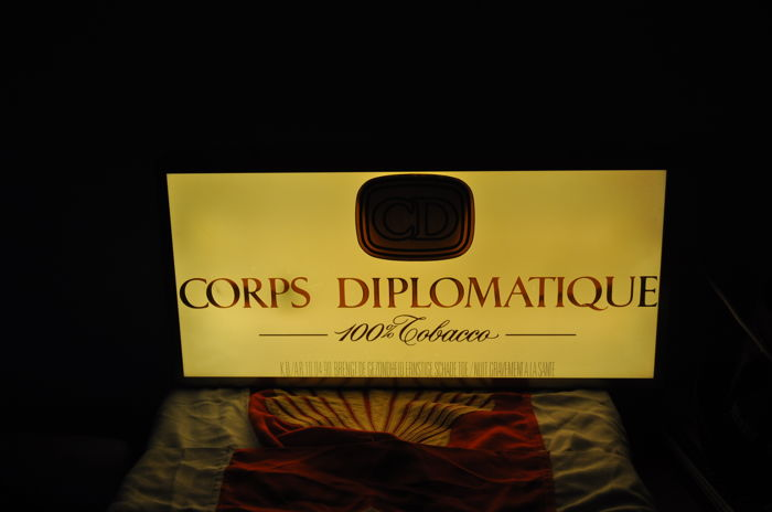 Corps Diplomatique. ... illuminated advertising