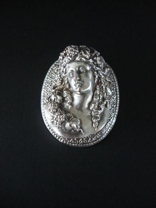 "Neoclassicism, silver plated brooch with a relief depicting a ""Bacchante"", a Greek mythological nymph."